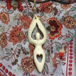 Goddess/Angel heart carved bone pendant